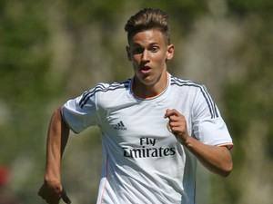 Marcos Llorente of Real Madrid runs with the ball during the UEFA Youth League Semi Final match between Real Madrid and Benfica Lisbon at Colovray Stadion on April 11, 2014 in Nyon, Switzerland.