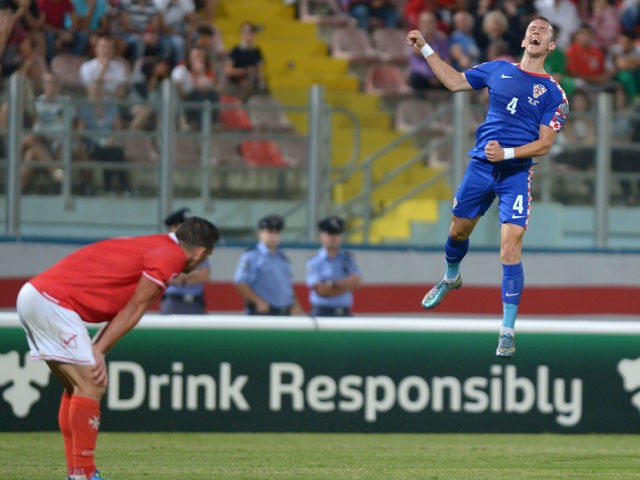 Croatia's Ivan Perisic (R) celebrates after scoring during the Euro 2016 qualifying football match between Malta and Croatia on October 13, 2015