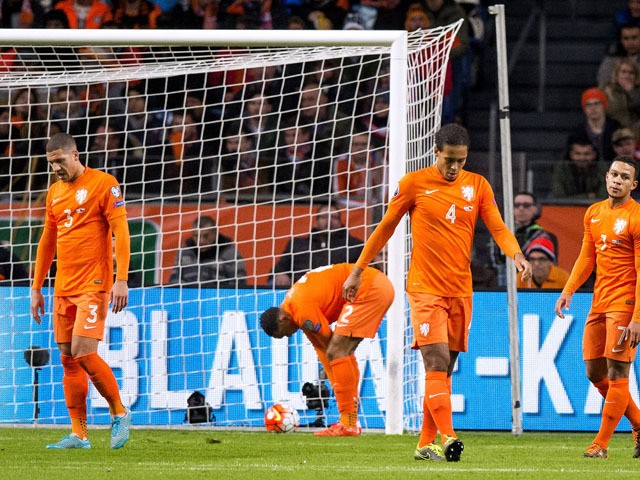 Dutch players react after Czech Republic scored during the Euro 2016 qualifying football match between the Netherlands and Czech Republic in Amsterdam on October 13, 2015