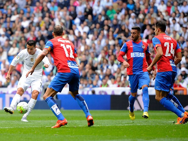 Cristiano Ronaldo of Real Madrid scores Real's 2nd goal during the La Liga match between Real Madrid CF and Levante UD at estadio Santiago Bernabeu on October 17, 2015