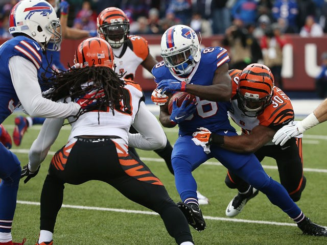 Ronald Darby #28 of the Buffalo Bills is takled by Cedric Peerman #30 of the Cincinnati Bengals during the first half at Ralph Wilson Stadium on October 18, 2015
