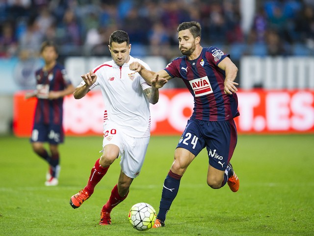 Victor Machin 'Vitolo' of Sevilla FC duels for the ball with Adrian Gonzalez of SD Eibar during the La Liga match between SD Eibar and Sevilla FC at Ipurua Municipal Stadium on October 17, 2015 in Eibar, Spain.