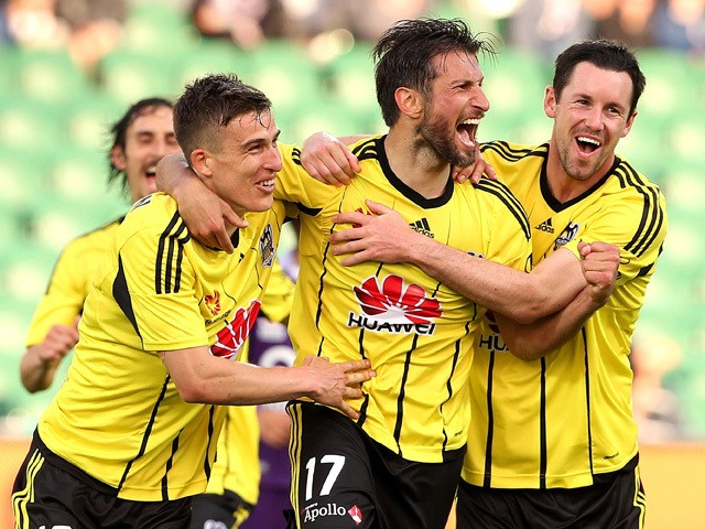 Vince Lia of the Phoenix celebrates with Louis Fenton and Blake Powell of the Phoenix after scoring a goal during the round two A-League match between the Perth Glory and Wellington Phoenix at nib Stadium on October 18, 2015