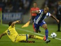 Maccabi's defender Eytan Tibi (L) vies with Porto's Algerian midfielder Yacine Brahimi during the UEFA Champions League group G football match FC Porto vs Maccabi Tel-Aviv FC at the Dragao stadium in Porto on October 20, 2015.