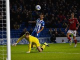 Sam Baldock of Brighton chips goalkeeper Frank Fielding of Bristol City only to see his shot cleared off the line during the Sky Bet Championship match between Brighton & Hove Albion and Bristol City at Amex Stadium on October 20, 2015 in Brighton, Englan
