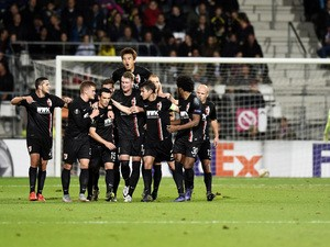 Augsburg's players celebrate opening the scoring during the UEFA Europa League Group L football match between AZ Alkmaar and Augsburg in Alkmaar on October 22, 2015