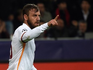 Roma's midfielder Daniele De Rossi celebrates scoring during the Group E, first-leg UEFA Champions League football match Bayer Leverkusen vs AS Roma in Leverkusen, western Germany on October 20, 2015.
