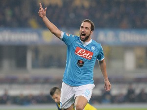 Gonzalo Higuain of SSC Napoli celebrates after scoring his opening goal during the Serie A match between AC Chievo Verona and SSC Napoli at Stadio Marc'Antonio Bentegodi on October 25, 2015