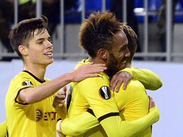 Dortmund's players celebrate a goal during the UEFA Europa League group C football match between Qabala FK and Borussia Dortmund in Baku on October 22, 2015