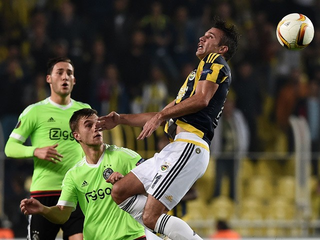 Fenerbahce's Robin Van Persie (R) heads the ball next to Ajax' Joel Veltman (C) and Ricardo Van Rhijn during the UEFA Europa League Group A football match Fenerbahce vs Ajax Amsterdam on October 22, 2015