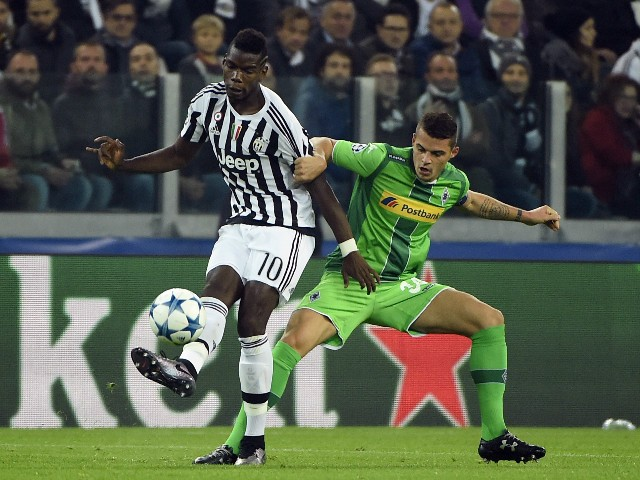 Juventus' midfielder from France Paul Pogba (L) vies with Moenchengladbach's Swiss midfielder Granit Xhaka during the UEFA Champions League football match Juventus vs Borussia Monchengladbach on October 21, 2015 at the Juventus stadium in Turin.