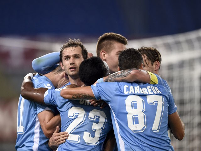 Lazio's midfielder from Bosnia-Herzegovina Senad Lulic (2ndL) celebrates with teammates after scoring during the Italian Serie A football match Lazio vs Torino on October 25, 2015