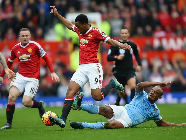 Anthony Martial of Manchester United is tackled by Vincent Kompany of Manchester City during the Barclays Premier League match between Manchester United and Manchester City at Old Trafford on October 25, 2015 in Manchester, England.