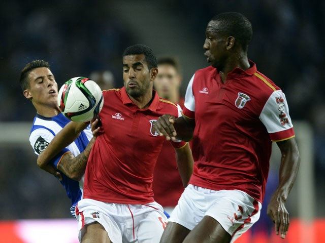Porto's Spanish forward Tello (L) vies with Sporting Braga's Brazilian defender Marcelo Goiano (C) and French defender Willy Boly during the Portuguese league football match FC Porto v SC Braga at the Dragao stadium in Porto on October 25, 2015