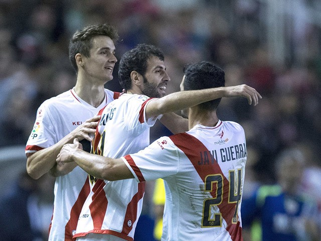 Roberto Tashorras (2ndR) celebrates scoring their opening goal with teammates Diego Llorente (L) and Javier Guerra (R) during the La Liga match between Rayo Vallecano de Madrid and RCD Espanyol at Estadio de Vallecas on October 23, 2015