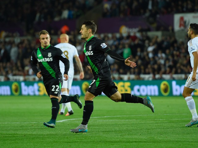 Bojan Krkic of Stoke City celebrates with Xherdan Shaqiri (22) as he scores their first goal from the penalty spot during the Barclays Premier League match between Swansea City and Stoke City at Liberty Stadium on October 19, 2015
