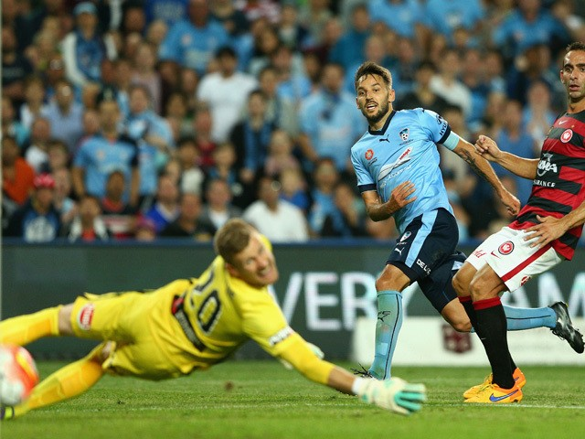 Milos Ninkovic of Sydney FC scores a goal during the round three A-League match between Sydney FC and Western Sydney Wanderers at Allianz Stadium on October 24, 2015