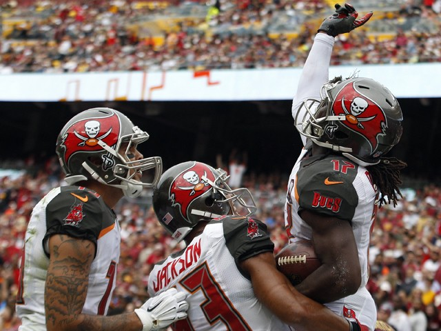 Wide receiver Donteea Dye #17 of the Tampa Bay Buccaneers celebrates a second quarter touchdown with wide receiver Vincent Jackson #83 of the Tampa Bay Buccaneers and wide receiver Mike Evans #13 of the Tampa Bay Buccaneers during a game against the Washi