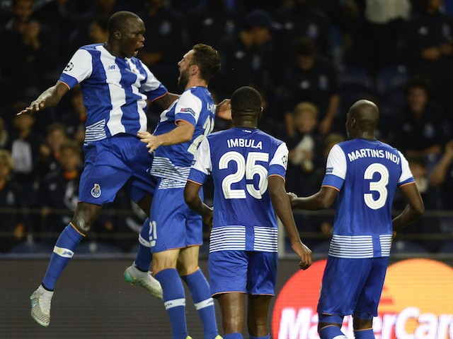 Porto's Cameroonian forward Vincent Aboubakar (L) celebrates with teammates after scoring a goal during the UEFA Champions League group G football match FC Porto vs Maccabi Tel-Aviv FC at the Dragao stadium in Porto on October 20, 2015.