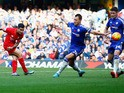 Philippe Coutinho of Liverpool scores his team's second goal during the Barclays Premier League match between Chelsea and Liverpool at Stamford Bridge on October 31, 2015