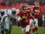 Alex Smith #11 of Kansas City Chiefs runs during the NFL game between Kansas City Chiefs and Detroit Lions at Wembley Stadium on November 01, 2015 in London, England.