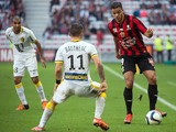 Lille's French midfielder Eric Bautheac (C) vies with Nice's French forward Hatem Ben Arfa (R) during the French L1 football match OGC Nice vs Lille at the Allianz Riviera stadium in Nice, southeastern France, on November 1, 2015.