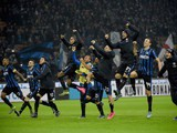 Inter Milan's players celebrate after the Italian Serie A football match Inter Milan vs AS Roma on October 31, 2015 at the San Siro Stadium in Milan.