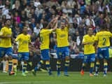 Las Palmas' midfielder Hernan celebrates his goal during the Spanish league football match Real Madrid CF vs UD Las Palmas at the Santiago Bernabeu stadium in Madrid on October 31, 2015