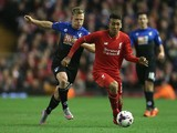 Roberto Firmino of Liverpool is closed down by Matt Ritchie of Bournemouth during the Capital One Cup Fourth Round match between Liverpool and AFC Bournemouth at Anfield on October 28, 2015 in Liverpool, England.