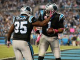 Mike Tolbert #35 and Cam Newton #1 of the Carolina Panthers celebrate a touchdown against the Philadelphia Eagles in the 3rd quarter during their game at Bank of America Stadium on October 25, 2015 in Charlotte, North Carolina.