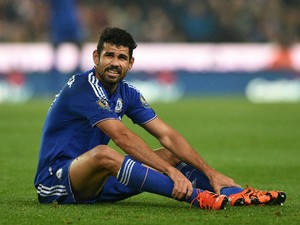The injured Diego Costa of Chelsea looks on prior to leaving the pitch due to injury during the Capital One Cup fourth round match between Stoke City and Chelsea at the Britannia Stadium on October 27, 2015 in Stoke on Trent, England.
