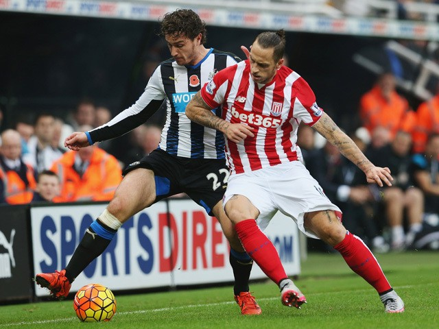 Daryl Janmaat of Newcastle United and Marko Arnautovic of Stoke City compete for the ball during the Barclays Premier League match between Newcastle United and Stoke City at St James' Park on October 31, 2015