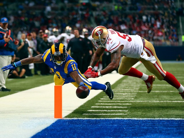 Tavon Austin #11 of the St. Louis Rams scores a touchdown past Ahmad Brooks #55 of the San Francisco 49ers in the second quarter at the Edward Jones Dome on November 1, 2015