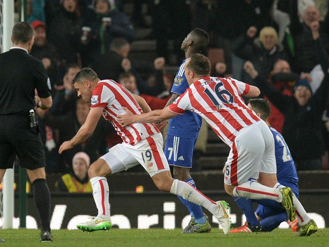 Stoke City's English-born Irish striker Jonathan Walters (C) celebrates scoring his team's first goal during the English League Cup fourth round football match between Stoke City and Chelsea at the Britannia Stadium in Stoke-on-Trent, central England on O