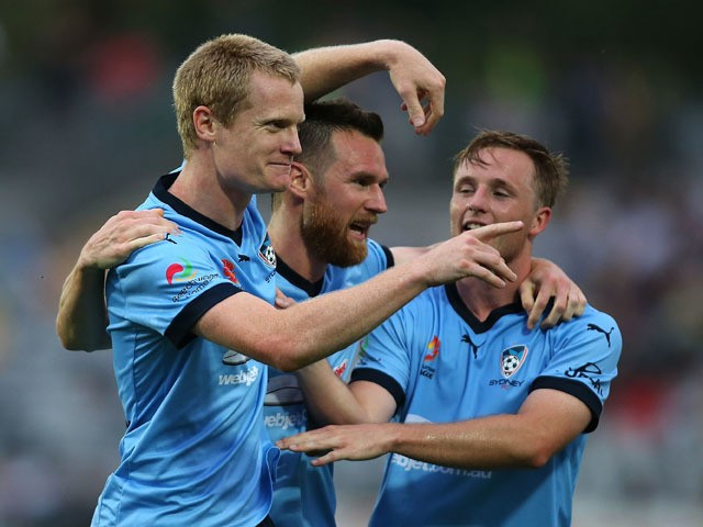 Matt Simon of Sydney FC celebrates with team mates after scoring a goal during the round four A-League match between the Central Coast Mariners and Sydney FC at Central Coast Stadium on October 31, 2015