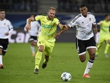 Gent's Belgian forward Laurent Depoitre (L) and Valencia's Brazilian defender Aderlan Santos vie for the ball during UEFA Champions League Group H second-leg football match between KAA Gent and Valencia CF at the KAA Gent Stadium in Ghent, Belgium on Nove