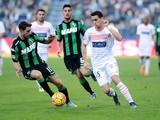 Sime Vrsaljko (L) of Sassuolo Calcio competes with Kevin Lasagna of Carpi FC during the Serie A match between US Sassuolo Calcio and Carpi FC at Mapei Stadium - Città del Tricolore on November 8, 2015 in Reggio nell'Emilia, Italy.