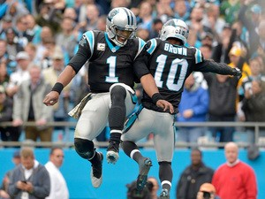 Cam Newton #1 and Corey Brown #10 of the Carolina Panthers celebrate after Brown's second quarter touchdown against the Green Bay Packers during their game at Bank of America Stadium on November 8, 2015