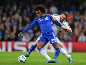 Chelsea's Brazilian midfielder Willian (L) vies with Dynamo Kiev's Portuguese defender Antunes during a UEFA Chamions league group stage football match between Chelsea and Dynamo Kiev at Stamford Bridge stadium in west London on November 4, 2015
