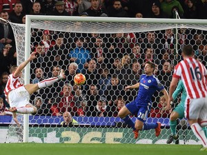 Stoke City's Austrian striker Marko Arnautovic (L) shoots to score the opening goal of the English Premier League football match between Stoke City and Chelsea at the Britannia Stadium in Stoke-on-Trent, central England on November 7, 2015.
