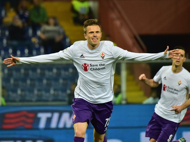 Fiorentina's midfielder from Slovenia Josip Ilicic celebrates after scoring a penalty during the Italian Seria A football match Sampdoria vs Fiorentina, on November 8, 2015