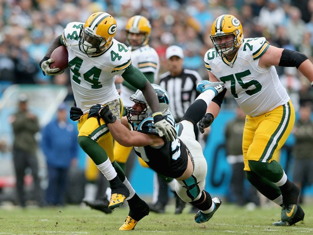 James Starks #44 of the Green Bay Packers runs the ball against Luke Kuechly #59 of the Carolina Panthers in the 1st quarter during their game at Bank of America Stadium on November 8, 2015