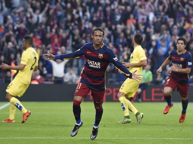 Barcelona's Brazilian forward Neymar da Silva Santos Junior (C) celebrates his goal during the Spanish league football match FC Barcelona vs Villarreal CF at the Camp Nou stadium in Barcelona on November 8, 2015.