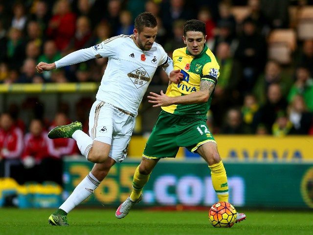 Gylfi Sigurdsson of Swansea City and Robbie Brady of Norwich City compete for the ball during the Barclays Premier League match between Norwich City and Swansea City at Carrow Road on November 7, 2015 in Norwich, England.