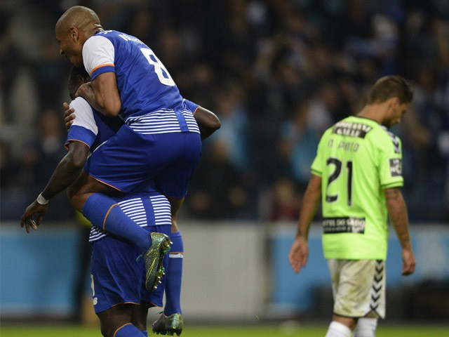 Porto's Cameroonian forward Vincent Aboubakar (L) is congratulated by teammate Algerian midfielder Yacine Brahimi after scoring a goal during the Portuguese league football match FC Porto vs Vitoria Setubal FC at the Dragao stadium in Porto on November 8,