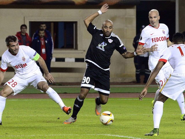 From L: Monaco's French midfielder Jeremy Toulalan, Monaco's Italian defender Andrea Raggi and Monaco's Brazilian defender Fortuna Dos Santos Wallace vie with Qarabag's forward from Sweden Samuel Armenteros (C) during the UEFA Europa League group J footba
