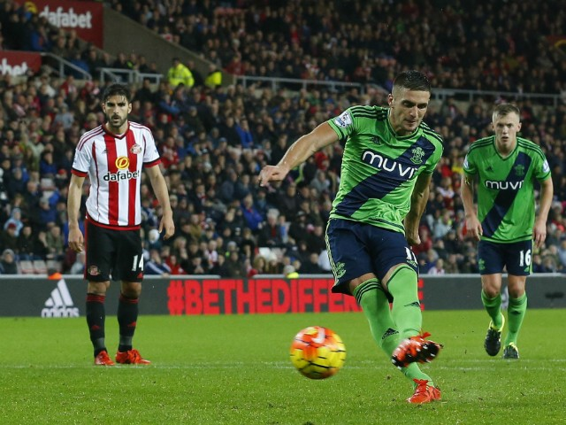 Southampton's Serbian midfielder Dusan Tadic (2nd R) scores the opening goal from the penalty spot during the English Premier League football match between Sunderland and Southampton at the Stadium of Light in Sunderland, north east England on November 7,