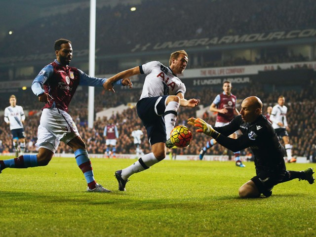 Harry Kane of Tottenham Hotspur is foiled by goalkeeper Brad Guzan of Aston Villa during the Barclays Premier League match between Tottenham Hotspur and Aston Villa at White Hart Lane on November 2, 2015