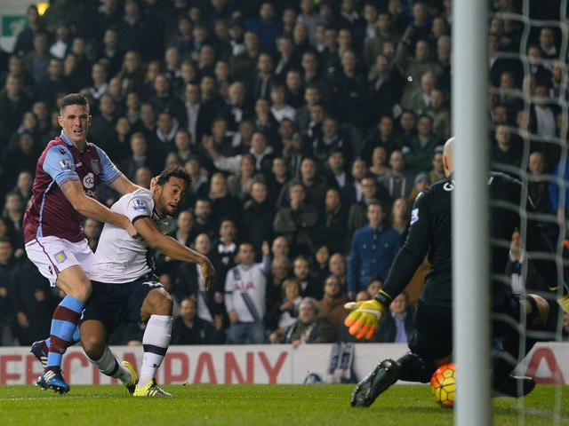 Tottenham Hotspur's Belgian midfielder Mousa Dembele (C) shoots and scores during the English Premier League football match between Tottenham Hotspur and Aston Villa at White Hart Lane in north London on November 2, 2015