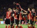 Belgium's Jan Vertonghen (C, No5) celebrates with teammates after scoring during the friendly international match between Belgium and Italy at Baudoin King Stadium in Brussels, on November 13, 2015.